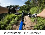 riding on top of hill  holding... | Shutterstock . vector #1143409097