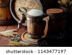 light foam beer in a glass on...   Shutterstock . vector #1143477197