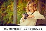 photographer girl with... | Shutterstock . vector #1143480281