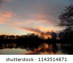 beautiful sunset over a lake.... | Shutterstock . vector #1143514871