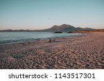 one man sitting on a sandy... | Shutterstock . vector #1143517301