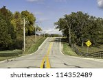 American country asphalt road with school bus sign - stock photo