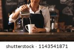 cropped shot of female barista... | Shutterstock . vector #1143541871