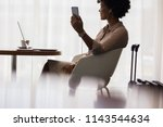 happy woman making video call... | Shutterstock . vector #1143544634