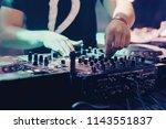 dj playing music at mixer... | Shutterstock . vector #1143551837