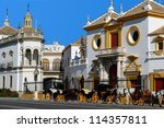 The Bullring (Plaza de toros de la Real Maestranza de Caballer���­a de Sevilla) with horse drawn carriages in the foreground, Seville, Seville Province, Andalusia, Spain, Western Europe.