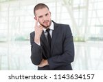young business man thinking at... | Shutterstock . vector #1143634157