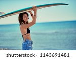 surf girl go to surfing  yong... | Shutterstock . vector #1143691481
