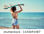 surf girl go to surfing ... | Shutterstock . vector #1143691487