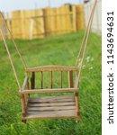 children's wooden rope swing in ... | Shutterstock . vector #1143694631