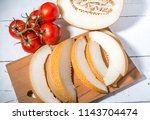 tomatoes on a branch and ripe... | Shutterstock . vector #1143704474