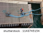 dock worker secures a cruise... | Shutterstock . vector #1143745154