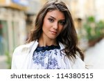 Portrait of a beautiful woman in urban background - stock photo