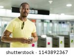 young man using smartphone and... | Shutterstock . vector #1143892367