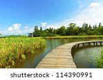 wetland pond and wooden bridge... | Shutterstock . vector #114390991