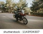 man riding a touring motorbike... | Shutterstock . vector #1143934307