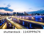 busy traffic road with city... | Shutterstock . vector #1143999674