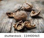 Nuts on rustic wooden table - stock photo