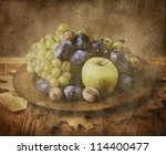 autumn fruit in wooden plate on ... | Shutterstock . vector #114400477
