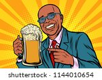 smiling man with a mug of beer... | Shutterstock .eps vector #1144010654