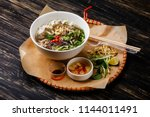 pho bo vietnamese soup with... | Shutterstock . vector #1144011491