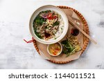 pho bo vietnamese soup with... | Shutterstock . vector #1144011521