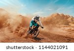 cyclist riding a bicycle.... | Shutterstock . vector #1144021091