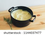mashed potato in a saucepan on... | Shutterstock . vector #1144037477