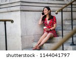 a young chinese asian woman... | Shutterstock . vector #1144041797