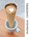 coffee waffle cone or hot...   Shutterstock . vector #1144058981