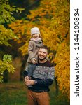happy father with his daughter... | Shutterstock . vector #1144100834