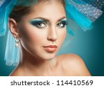 beautiful woman with blue make... | Shutterstock . vector #114410569
