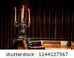 silver candle holder with... | Shutterstock . vector #1144127567