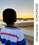 alvor  portugal  july 21st ... | Shutterstock . vector #1144154144
