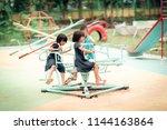 Happy Asian Kids Playing Carousel - Fine Art prints