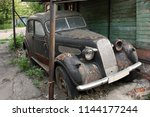 the old car 1930s lives out the ... | Shutterstock . vector #1144177244