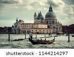 gondola and venice  church...   Shutterstock . vector #1144214297