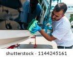 boat maintenance   a man... | Shutterstock . vector #1144245161