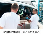 boat maintenance   two men... | Shutterstock . vector #1144245164