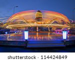Revolving carousel enlarge its ride speed by twice - stock photo