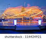 Revolving carousel is ride its visitors at speed - stock photo