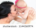 picture of happy mother with... | Shutterstock . vector #1144260974