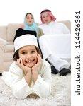 Happy Arabic family at home - stock photo