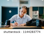a young cacuasian woman in a... | Shutterstock . vector #1144283774