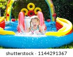 Child Playing In Inflatable...