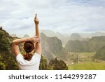 young woman standing on the... | Shutterstock . vector #1144299287