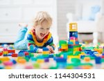 child playing with colorful toy ... | Shutterstock . vector #1144304531