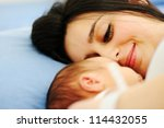 Woman holding her 2 days old newborn baby - stock photo