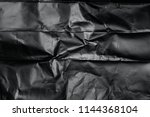 black plastic background | Shutterstock . vector #1144368104