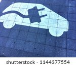 a parking space for electric... | Shutterstock . vector #1144377554